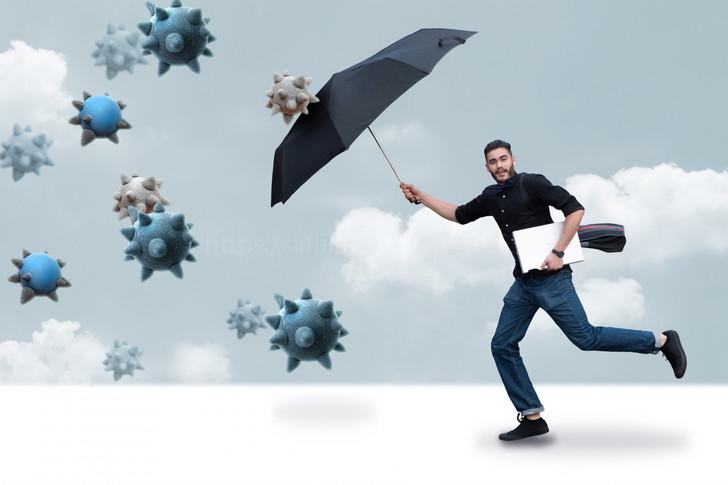 傘で防ぐ男性